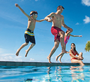 Family jumping into pool at Sunscape Resorts & Spas